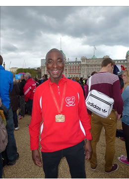 Fola, one of our relieved and happy runners at the finish line